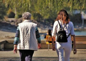 Mother and Adult Daughter Walking and Talking