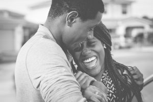 African American Husband and Wife Hugging and Smiling