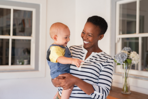 Adoption Tax Credit blog image: An African American mother holding her new infant.